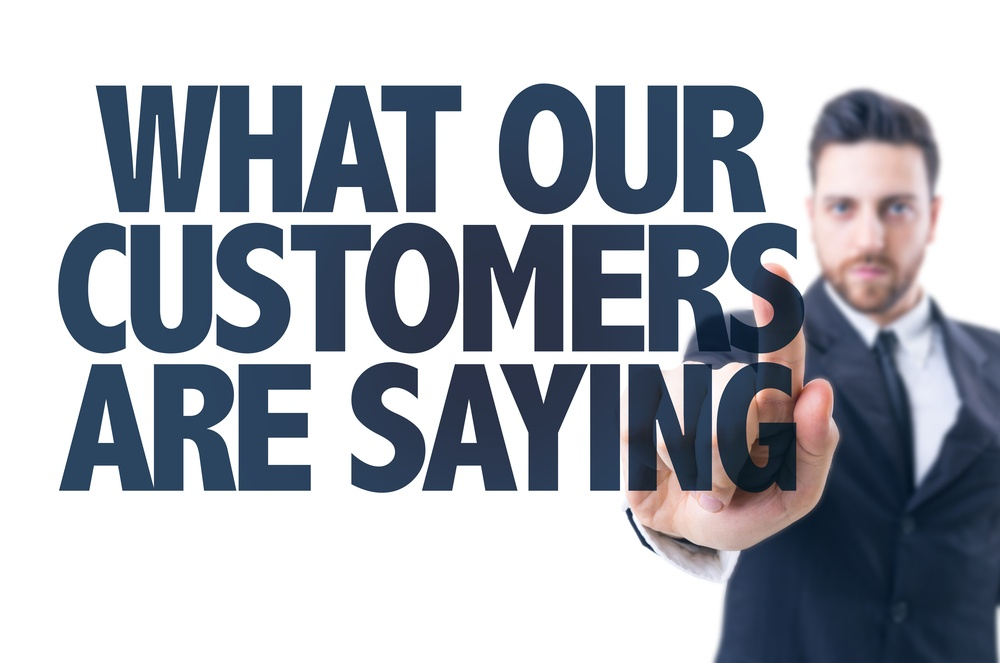 Business man pointing the text What Our Customers Are Saying.jpeg