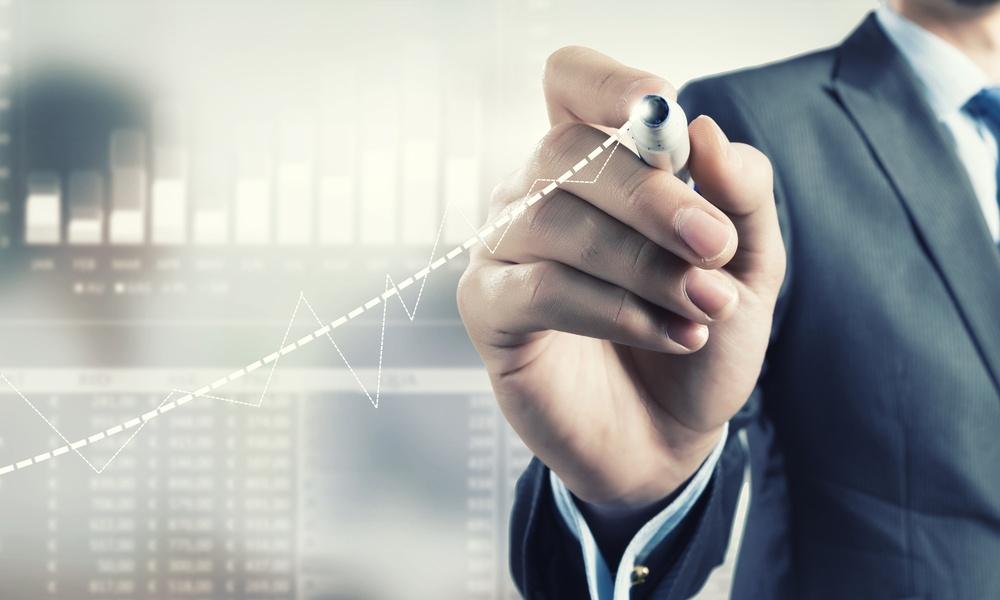 Businessman hand drawing increasing graph on media screen.jpeg