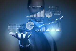 Close up of businesswoman holding graphs in hand.jpeg