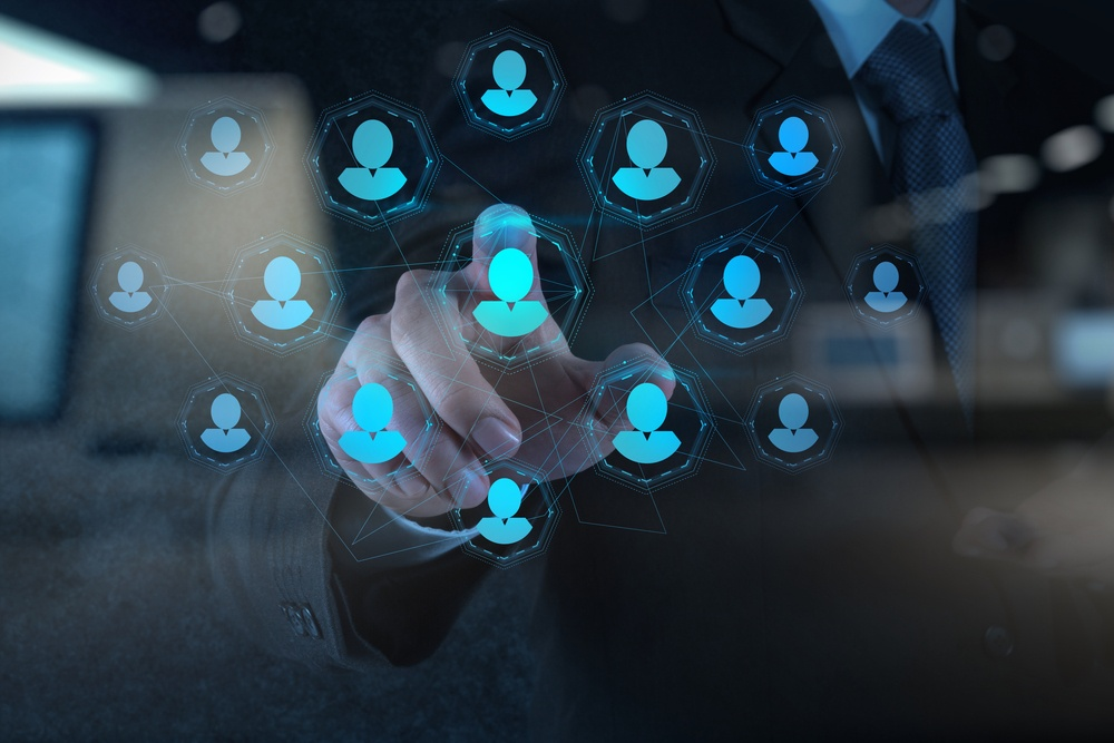 Double exposure of businessman hand points human resources, CRM and social media as concept