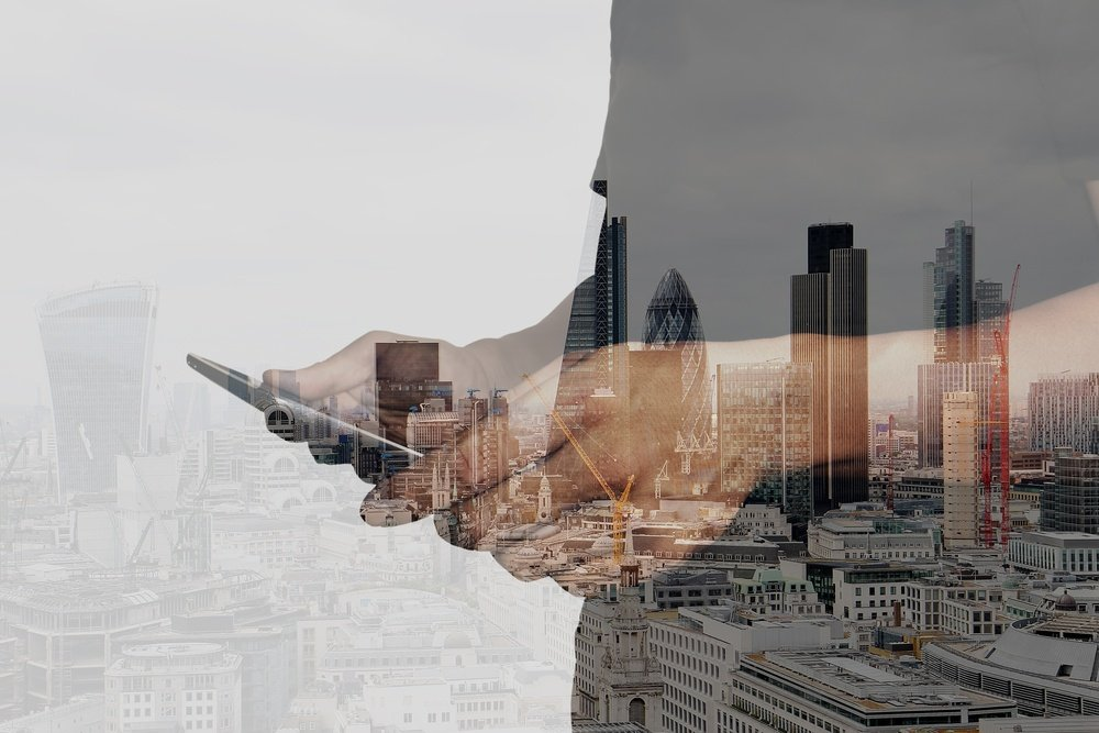 Double exposure of success businessman using digital tablet with london building and social media diagram.jpeg