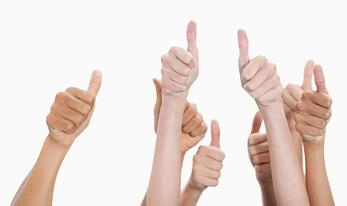 Hands up and thumbs raised against white background.jpeg