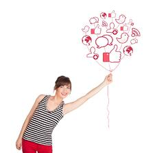 Happy young lady holding social icon balloon.jpeg
