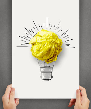 hand drawn light bulb with crumpled paper ball on paper poster as creative concept