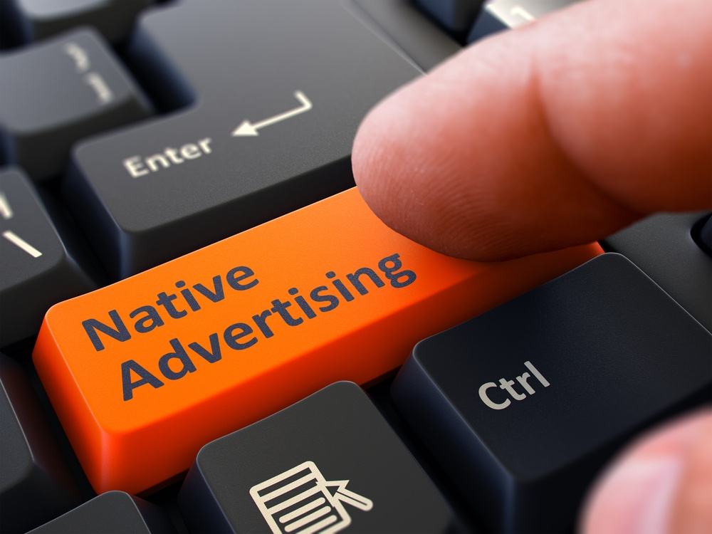 Native Advertising Button. Male Finger Clicks on Orange Button on Black Keyboard. Closeup View. Blurred Background..jpeg